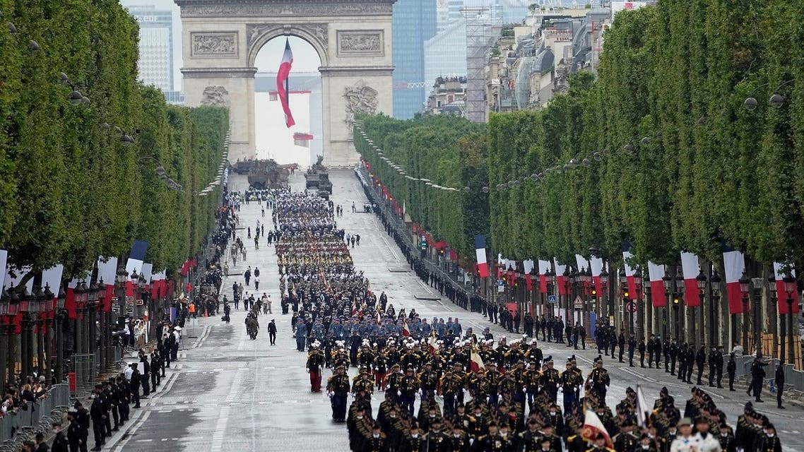 Troops walk down the Champs-Elysees avenue during the Bastille Day parade in Paris, France, July 14, 2021. (Michel Euler/Pool via Reuters)