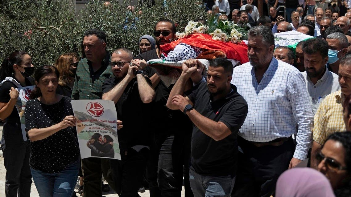 Palestinian mourners carry the body of Suha Jarrar, 30-year-old daughter of Khalida Jarrar, who is a prisoner in an Israeli jail, during her funeral, in the West Bank city of Ramallah, Tuesday, July 13, 2021. (AP/Majdi Mohammed)