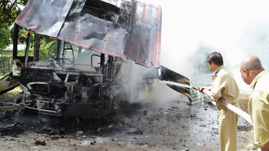 File photo of firefighters near a burning bus in Pakistan. (File photo: AFP)