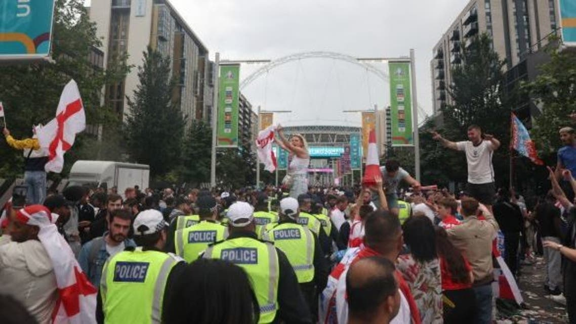Fans force way into Wembley