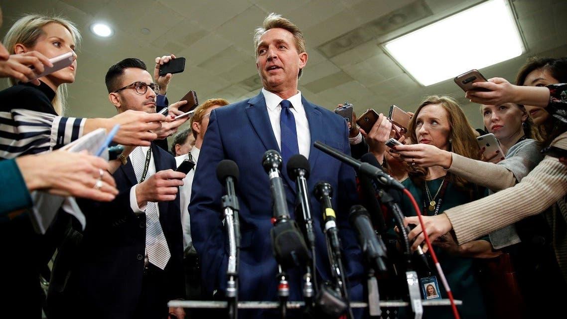 Senator Jeff Flake speaks to the media on Capitol Hill in Washington, Nov. 28, 2018. (Reuters)