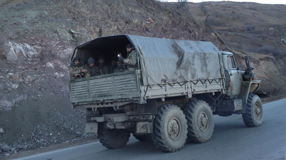 Ethnic Armenian soldiers drive a truck while leaving Karvatchar town in the region of Nagorno-Karabakh, November 24, 2020. The recent signing of a ceasefire deal ended a military conflict between Azerbaijan's troops and ethnic Armenian forces in the breakaway region. Picture taken November 24, 2020. (Reuters)