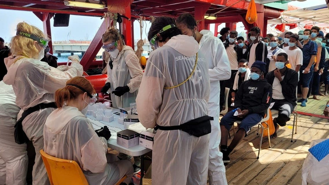 """Migrants are being tested for the coronavirus disease (COVID-19) onboard """"Ocean Viking"""", in Augusta, Sicily, Italy July 9, 2021. (Claire Juchat/SOS MEDITERRANEE/Handout via Reuters)"""