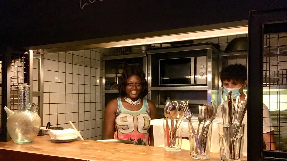 Chef Mariam Sesay prepares her dishes for her first customers. (Image: Robert McKelvey)