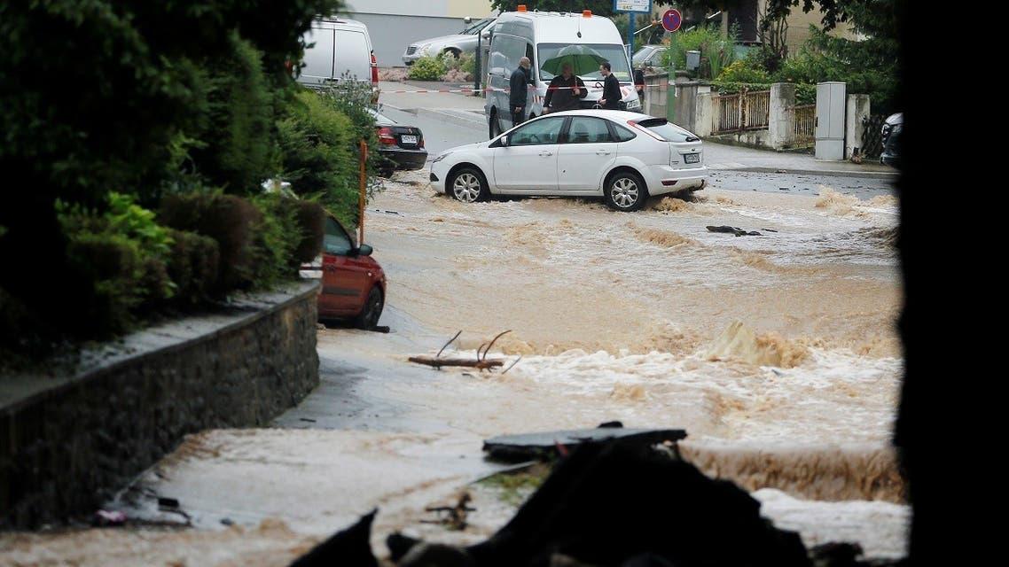 A flooded street is seen following heavy rainfalls in Hagen, Germany, on July 14, 2021. (Reuters)