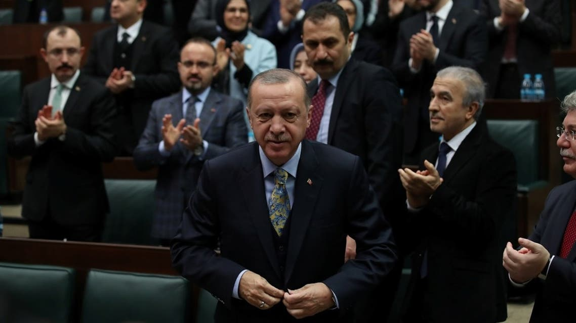 Turkish President Recep Tayyip Erdogan leaves his seat to address members of parliament from his ruling AK Party (AKP) during a meeting at the Turkish parliament in Ankara, Turkey, January 15, 2019. (Reuters/Umit Bektas)