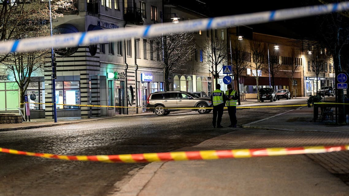 Police officers work behind barricade tape at a knife attack site in Vetlanda, Sweden March 3, 2021. (Reuters)