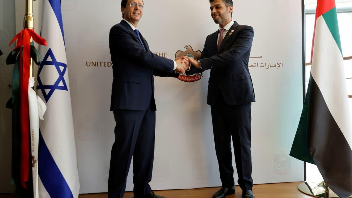 UAE Ambassador to Israel, Mohamed Al Khaja, and Israeli President Isaac Herzog shake hands during the opening ceremony of the Emirati embassy in Tel Aviv, Israel July 14, 2021. (Reuters)