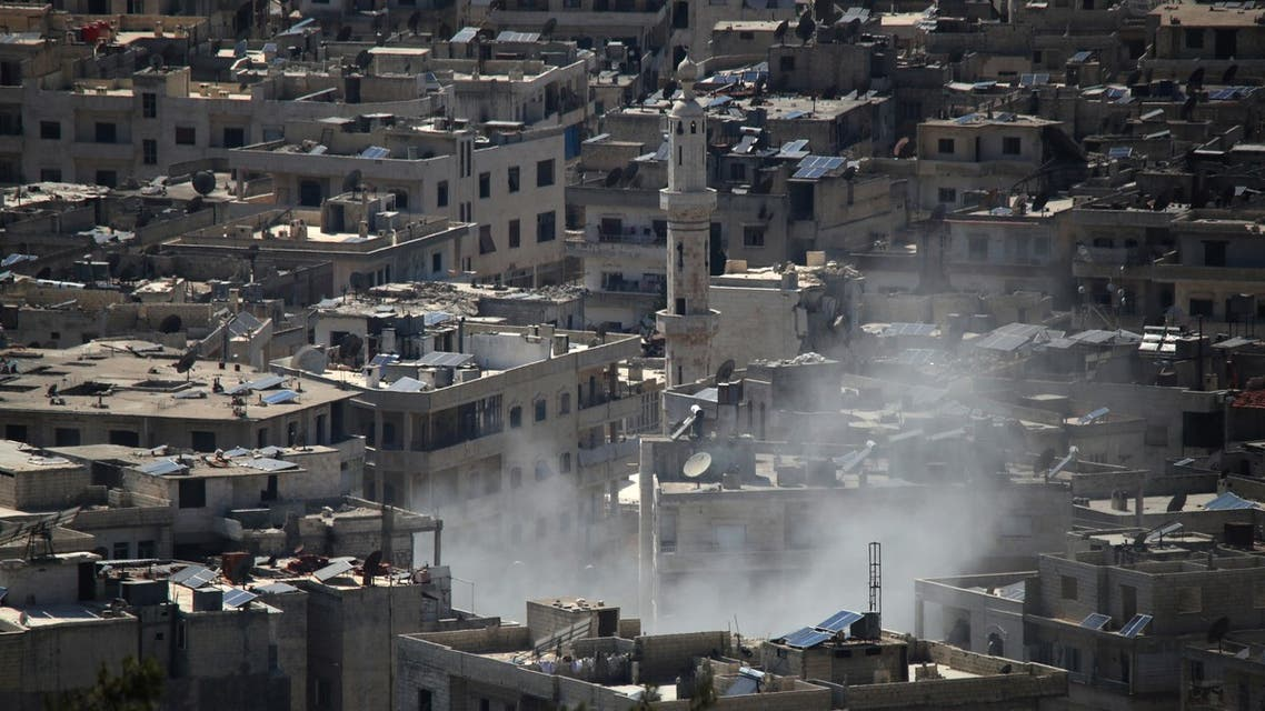 Smoke billows above the Syrian town of Ariha in the rebel-held northwestern Idlib province during reported bombing by pro-government forces on June 28, 2021.