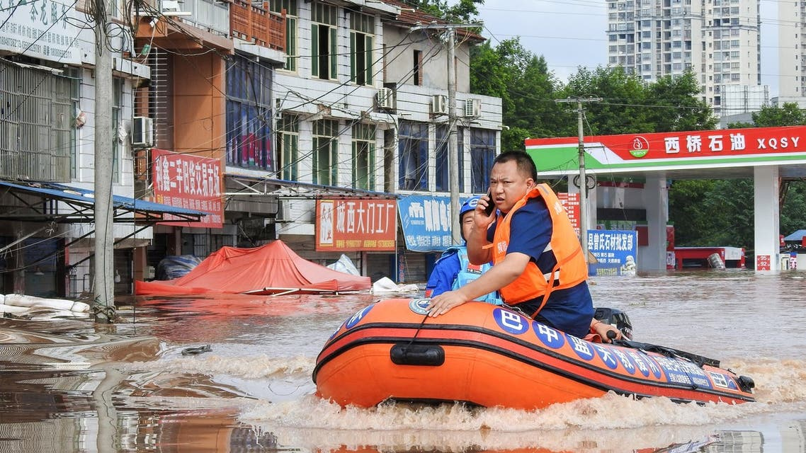 This photo taken on July 11, 2021 shows rescuers searching for residents affected by flood following heavy rains in Dazhou, in China's southwestern Sichuan province. (File photo: AFP)