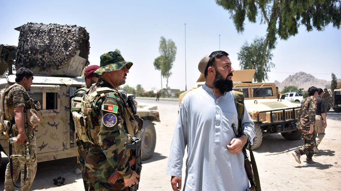 Afghan security personnel stand guard along the road amid ongoing fight between Afghan security forces and Taliban fighters in Kandahar on July 9, 2021.