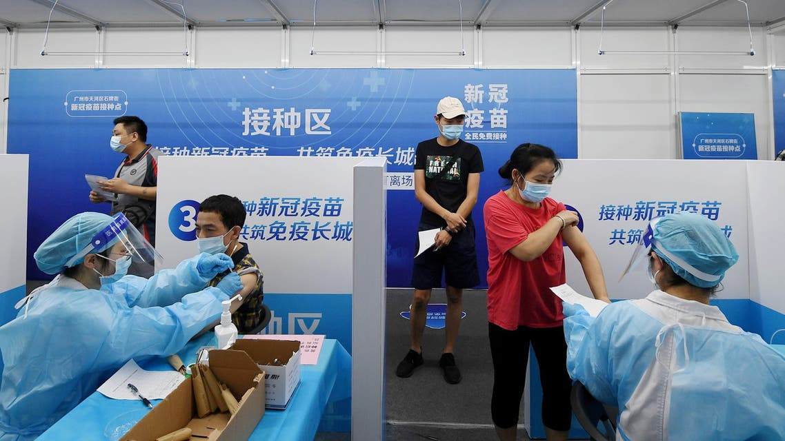 Residents receive vaccines against the coronavirus disease (COVID-19) at a makeshift vaccination site in Guangzhou, Guangdong province, China June 21, 2021. (Reuters)