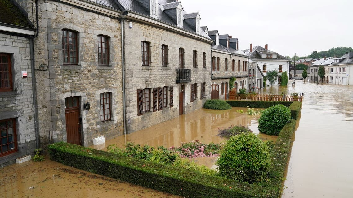 This picture shows a flooded street in Rochefort on July 15 2021 as disaster plan has been declared in Belgium's provinces of Liege, Luxembourg and Namur after heavy rains and floods lashing western Europe have killed at least two people in the country.