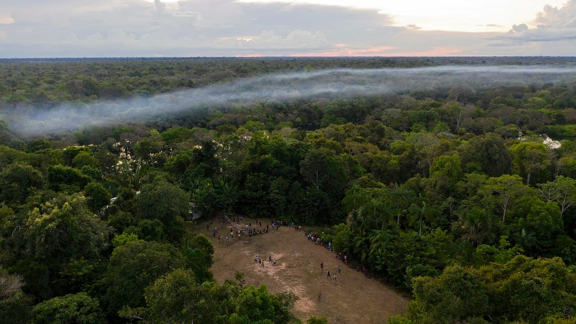 Aerial view of a football game taking place in a forest clearing in the Bauana community, municipality of Carauari, in the heart of the Brazilian Amazon Forest, on March 15, 2020. Many young people in the heart of the Amazon rainforest choose their community over the city.