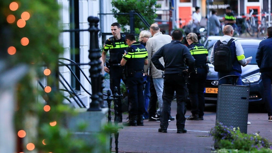 Police officers investigate the area where Dutch celebrity crime reporter Peter R. de Vries was reportedly shot and seriously injured, in Amsterdam, Netherlands, on July 6, 2021. (Reuters)
