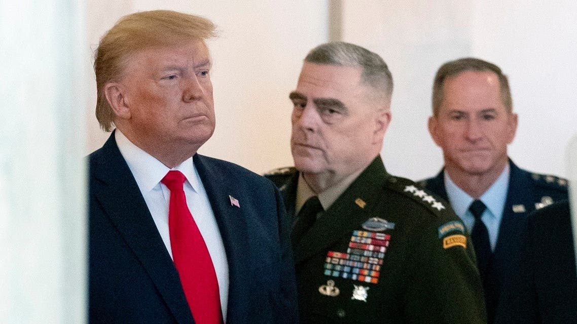 President Donald Trump after a ballistic missile strike that Iran launched against Iraqi air bases housing US troops, Jan. 8, 2020, accompanied by Joint Chiefs Chairman Gen. Mark Milley. (AP)