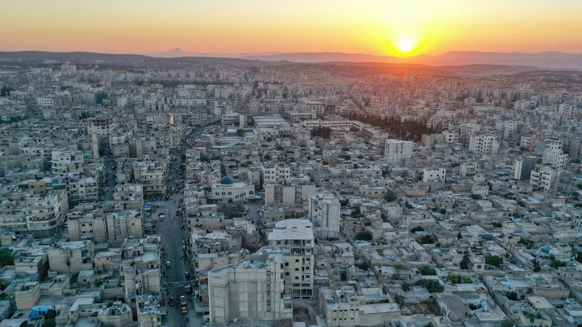 A drone picture taken on June 29, 2021, shows the sun setting over the opposition-held northwestern city of Idlib. (AFP)