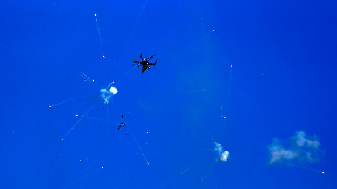 An Israeli drone fires stun grenades to disperse Palestinians protesting against the tension in Jerusalem and the Israeli-Gaza fighting on May 18, 2021, near the settlement of Beit El and Ramallah in the occupied West Bank.