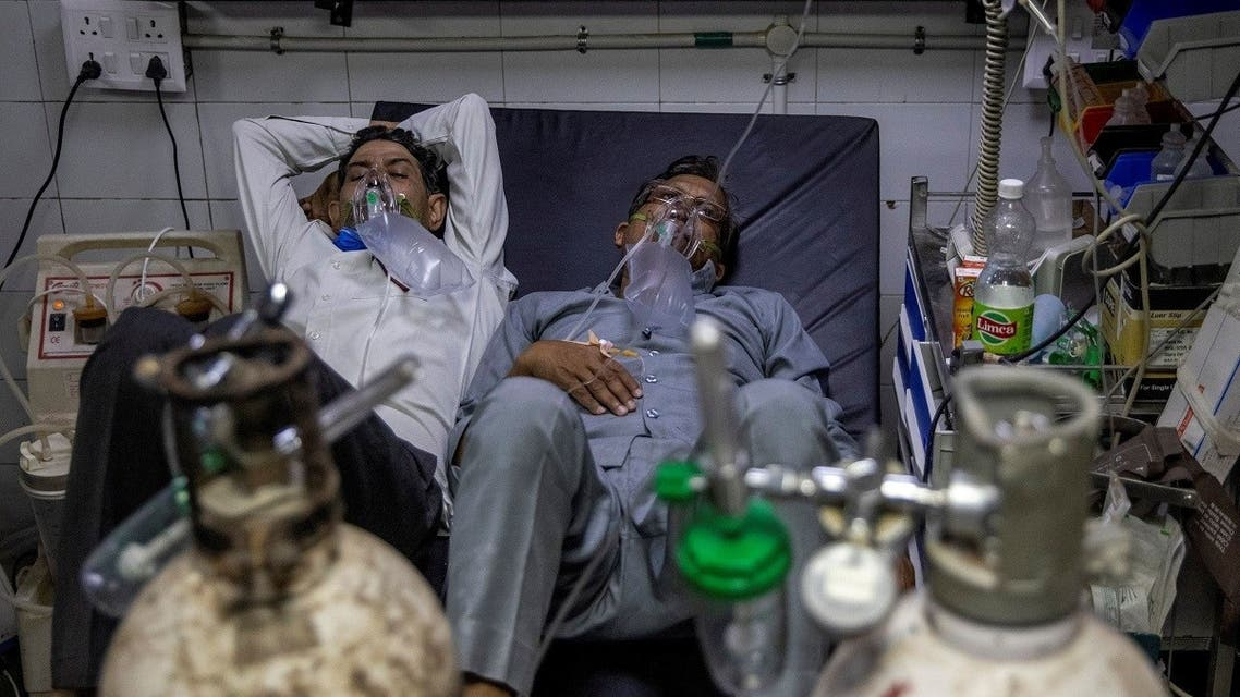 Patients suffering from the coronavirus disease (COVID-19) get treatment at the casualty ward in Lok Nayak Jai Prakash (LNJP) hospital, amidst the spread of the disease in New Delhi, India April 15, 2021. (Reuters)