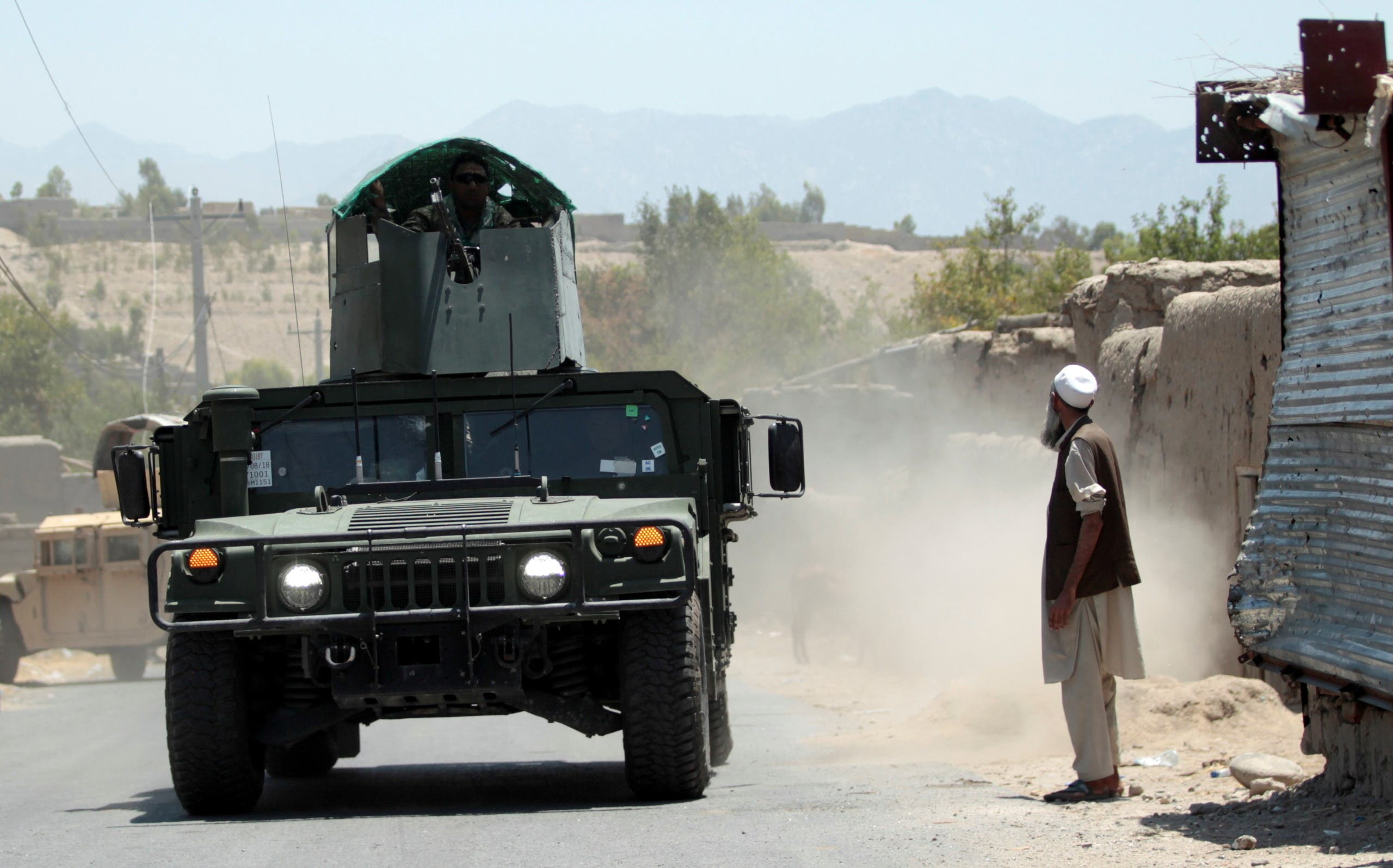 Afghan National Army (ANA) soldiers patrol the area near a checkpoint recaptured from the Taliban, in the Alishing district of Laghman province, Afghanistan July 8, 2021. (Reuters)