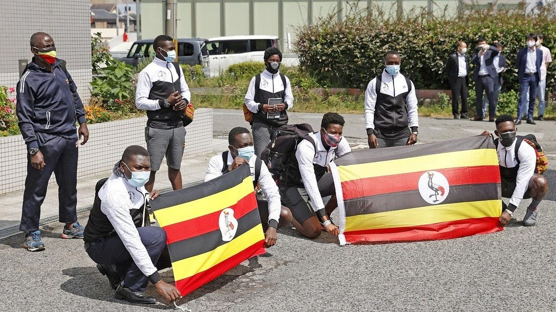 Members of Uganda's Olympic team pose for a photograph upon their arrival at their pre-Olympics camp host town, after a member of their team has tested positive for the coronavirus disease (COVID-19) and was barred entry into Japan, in Izumisano, Osaka . (Reuters)