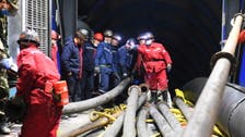 Chinese workers trapped in flooded highway tunnel for second day