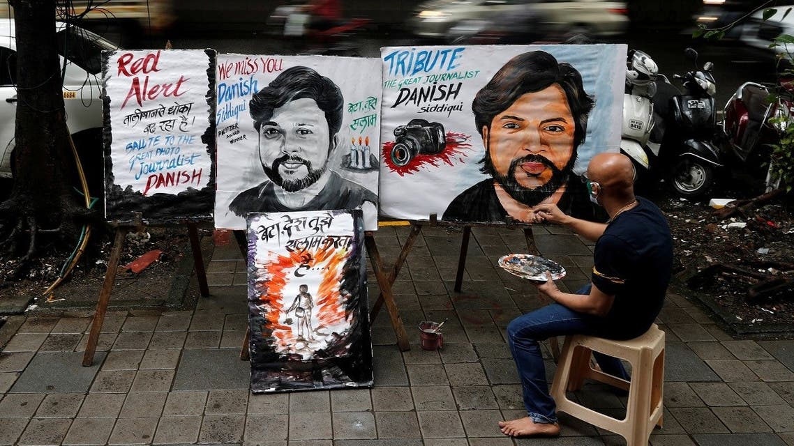 An artist applies finishing touches to a painting of Reuters journalist Danish Siddiqui, after he was killed, outside an art school in Mumbai, India, July 16, 2021. (Reuters)