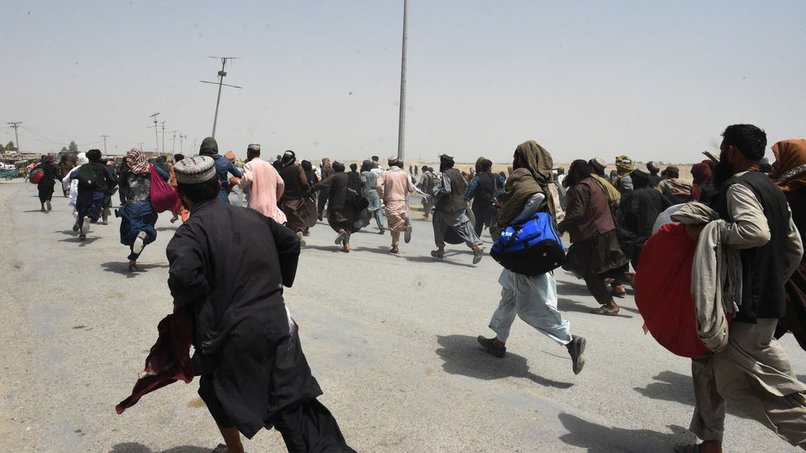 People rush towards a border crossing point in Pakistan's border town of Chaman on July 17, 2021, after Pakistan partially reopened its southern crossing with Afghanistan, shut off since the Taliban seized control of the strategic border town on the other side. (AFP)