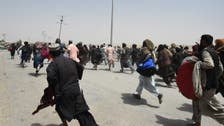 Pakistan allows thousands to cross into border town seized by Taliban