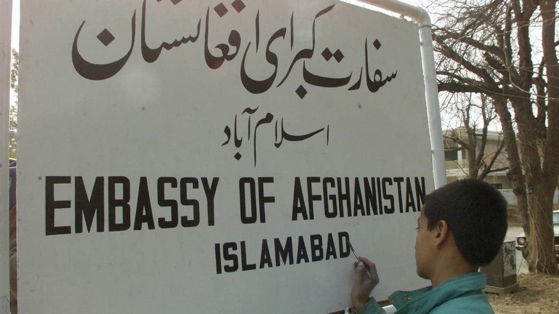 A young painter writes a new sign for the Afghan embassy in the Pakistan capital Islamabad February 13, 2002. Pakistan ordered the vanquished Taliban government to close its embassy in November last year. The new interim government in Afghanistan, led by Hamid Karzai, is likely to reopen the embassy next week. (Reuters)
