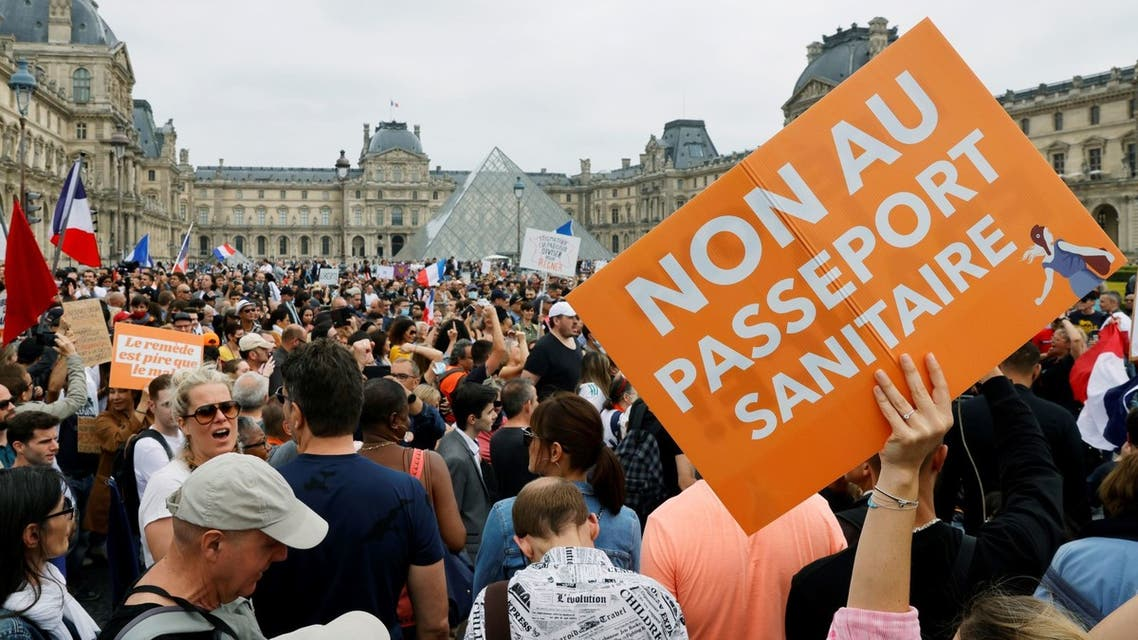 Demonstrators attend a protest against the new measures announced by French President Emmanuel Macron to fight the coronavirus disease (COVID-19) outbreak, in Paris, France, July 17, 2021. (Reuters)