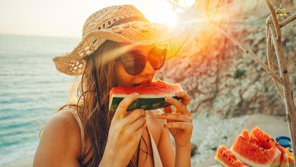 تناول البطيخ بطيخ