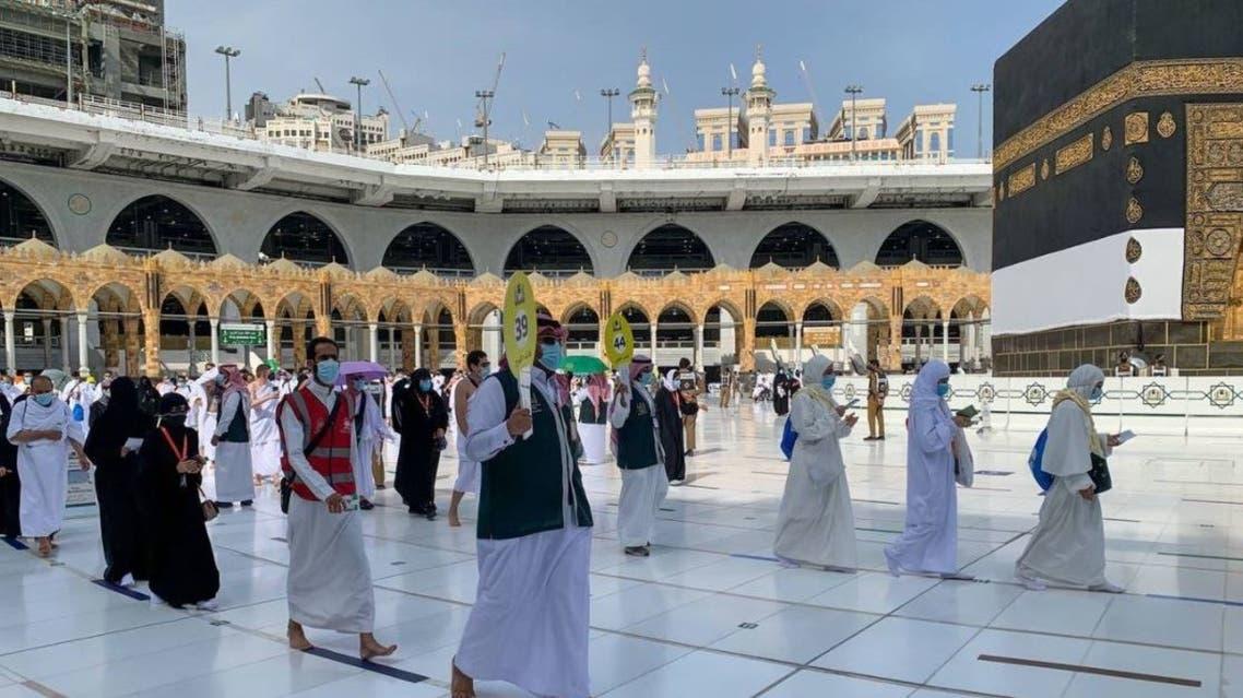 A guide leads Muslims as they begin the Hajj ritual on July 17, 2021 amid the coronavirus pandemic in Mecca, Saudi Arabia. (Twitter)
