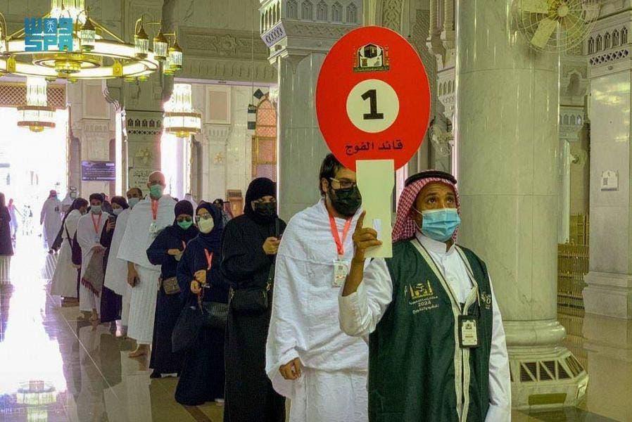 A guide leads Muslims as they begin the Hajj ritual on July 17, 2021 amid the coronavirus pandemic in Mecca, Saudi Arabia. (SPA)