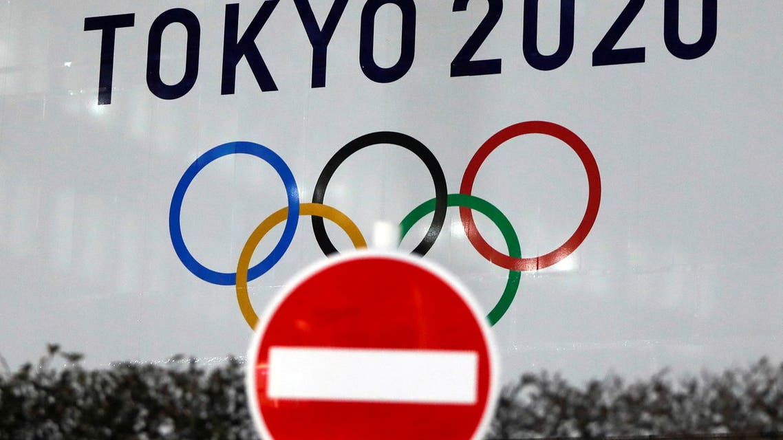 The logo of Tokyo 2020 Olympic Games that have been postponed to 2021 due to the coronavirus disease (COVID-19) outbreak, is seen through a traffic sign at Tokyo Metropolitan Government Office building in Tokyo, Japan January 22, 2021. (File Photo: Reuters)