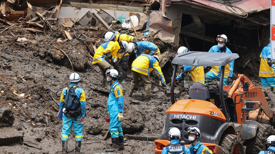 Police search for missing people at the scene of a landslide following days of heavy rain in the Izusan area of Atami, Shizuoka Prefecture on July 7, 2021. (AFP)