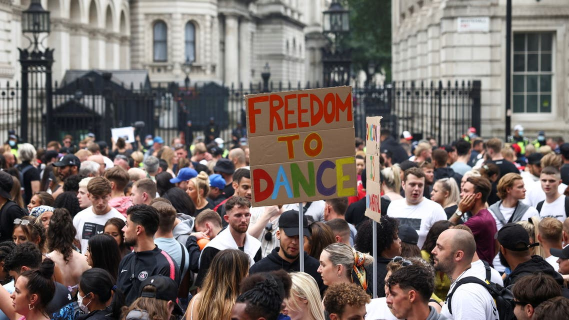 Demonstrators calling for nightclubs to reopen gather outside Downing Street during the Save Our Scene protest, amid the coronavirus disease (COVID-19) pandemic, in London, Britain June 27, 2021. (Reuters)