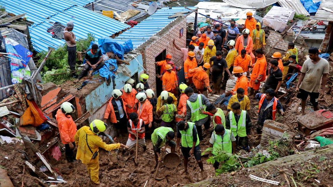 Rescue workers search for survivors after a residential house collapsed due to landslide caused by heavy rainfall in Mumbai, India, July 18, 2021. (Reuters)