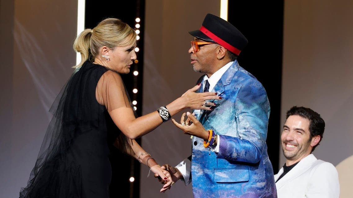 Director Julia Ducournau, Palme d'Or award winner for the film Titane, is congratulated by Spike Lee, Jury President of the 74th Cannes Film Festival. (Reuters)