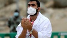 Masked Hajj pilgrims on Mount Arafat pray for COVID-19-free world