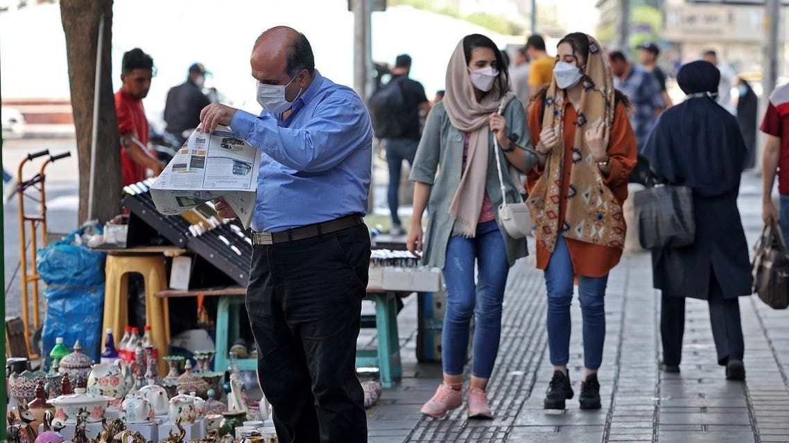 Iranians wear face masks as a measure against the COVID-19 coronavirus, in a street in the capital Tehran, on July 7, 2021. (Atta Kenare/AFP)