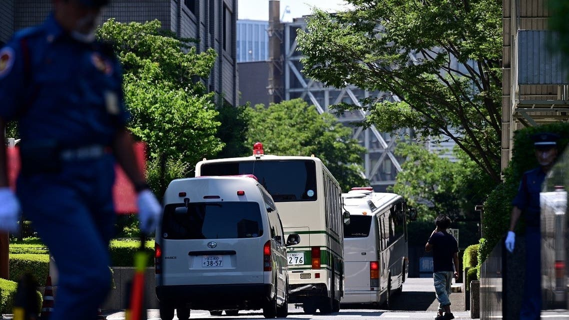 A bus believed to be carrying former US special forces member Michael Taylor and his son Peter arrives at the Tokyo district court ahead of their verdict in Tokyo on July 19, 2021. (Philip Fong/AFP)
