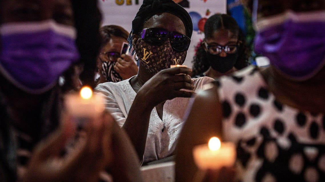 People attend a vigil in honor of Haiti's slain president Jovenel Moise, in Little Haiti neighborhood, Miami, Florida, on July 16, 2021. (AFP)