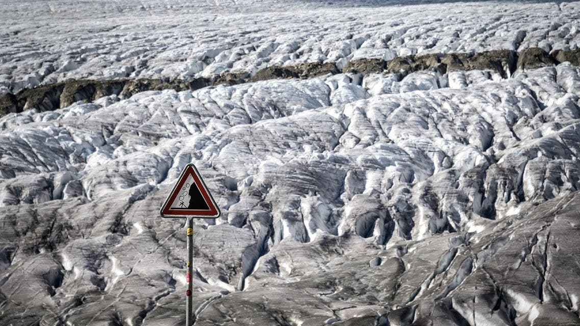 This picture taken on October 01, 2019 shows a warning sign for rockslide next to the Aletsch glacier above Bettmeralp, Swiss Alps.The mighty Aletsch – the largest glacier in the Alps – could completely disappear by the end of this century if nothing is done to rein in climate change, a study showed on September 12, 2019 by ETH technical university in Zurich. (Fabrice Coffrini/AFP)