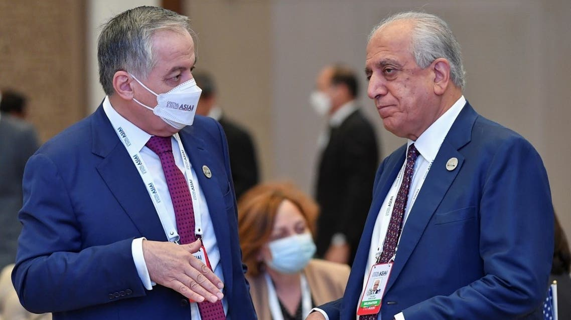 Tajikistan's Foreign Minister Sirojiddin Muhriddin and US Special Representative for Afghanistan Reconciliation, Zalmay Khalilzad talk during Central-South Asia trade summit in Tashkent, Uzbekistan, on July 16, 2021. (Reuters)