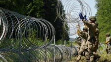 Belarusian guards cross into Lithuania with dozens of migrants