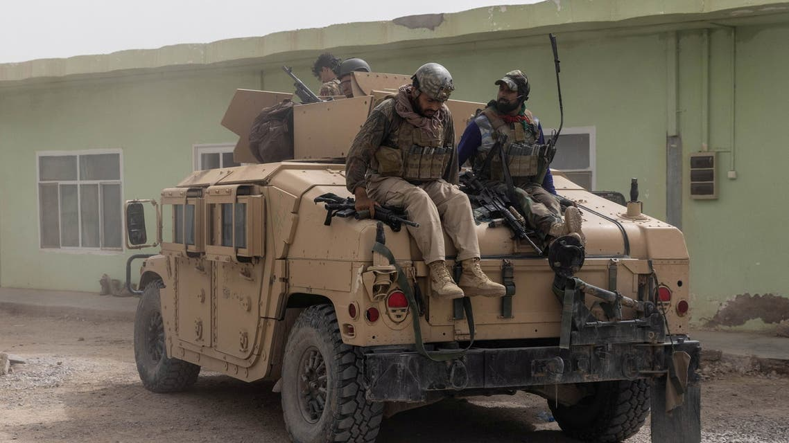 Members of Afghan Special Forces climb down from a humvee as they arrive at their base after heavy clashes with Taliban during the rescue mission of a police officer besieged at a check post, in Kandahar province, Afghanistan, July 13, 2021. (Reuters)