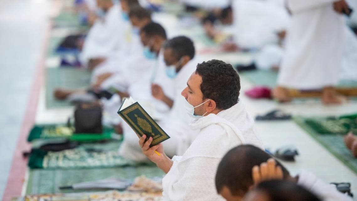 A pilgrim reads the Quran in the Al Namirah Mosque in Arafat during Hajj, in Mecca. (Photo Courtesy: The Two Holy Mosques Twitter)