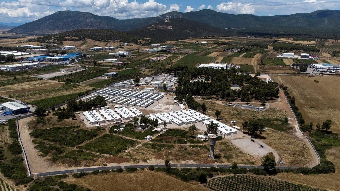 An aerial view of the Ritsona camp for refugees and migrants surrounded by a newly built concrete wall, in Greece, on June 15, 2021. (Reuters)