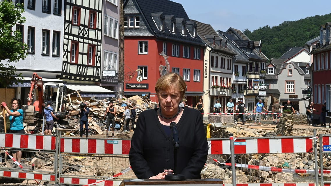 German Chancellor Angela Merkel gives a statement to news media during a visit in flood-stricken Bad Muenstereifel, Germany July 20, 2021. Christof Stache/Pool via REUTERS